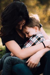 mom hugging son divorce and custody separation issues child custody battle tips