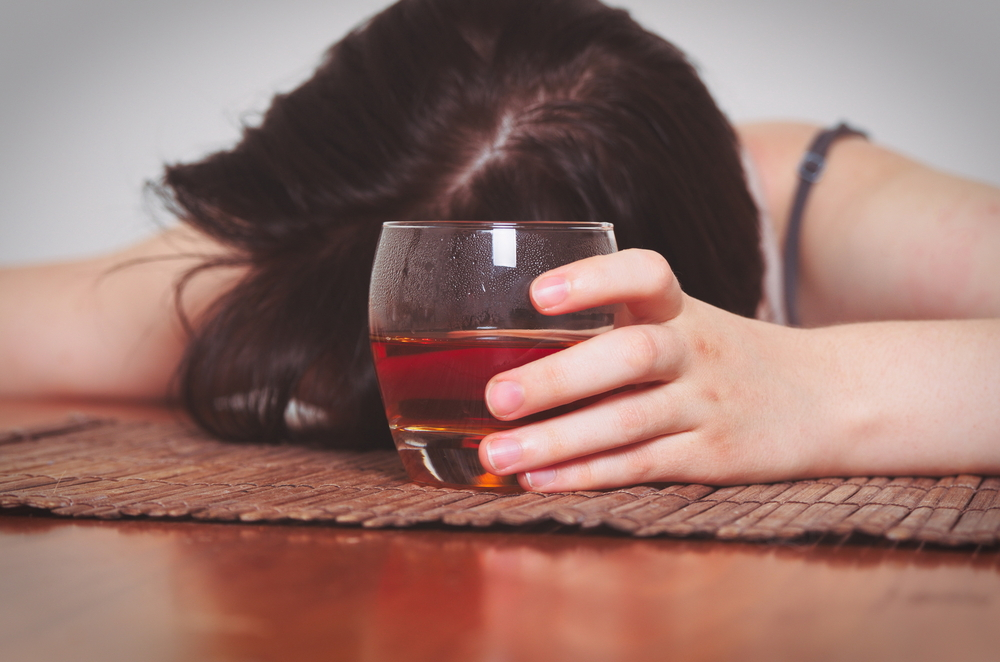 alcohol abuse alcoholic woman with wine passed out relapse warning signs