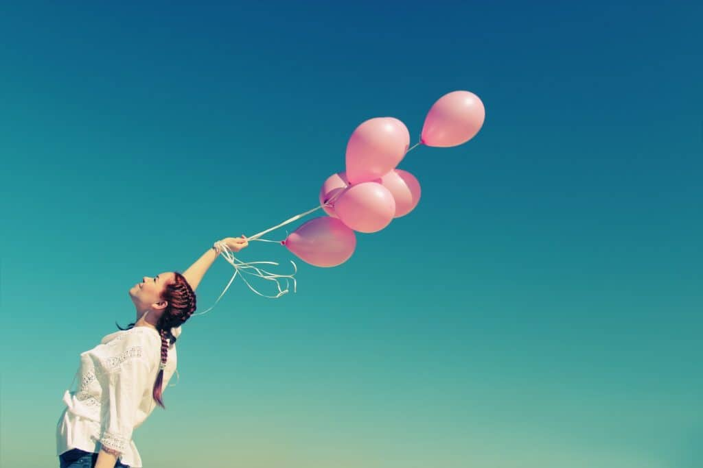 woman with balloons no apologies for positive attitude bloominash